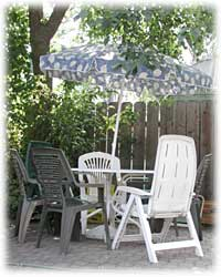 Backyard patio for guest's use.